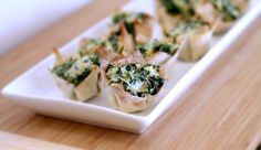 These Spinach and Artichoke Wontons are super simple to make and are perfect for your holiday or football gathering!