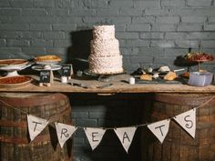 Create a rustic dessert table by placing a piece of plywood across two whiskey barrels. Decorate with a burlap bunting. Give these wedding desserts a try »
