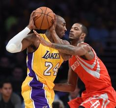 Kobe Bryant (L) of the Los Angeles Lakers is guarded by Trevor Ariza (R) of the Houston Rockets during the Laker's first regular season NBA game, October 28, 2014 at Staples Center in Los Angeles, California. AFP PHOTO / Robyn BeckROBYN BECK/AFP/Getty Images