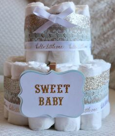 A personal favorite from my Etsy shop https://www.etsy.com/listing/539839663/gold-and-blue-diaper-cake-unisex-diaper