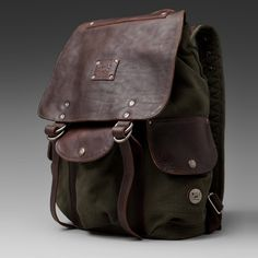 Will Leather Goods 'Lennon' Backpack is a pack for your inner Indiana Jones. Rugged but feminine in dark green canvas and leather outer flap, this bag has plenty of room for a travel journal and camera.