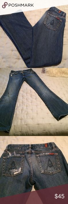 """7"" Distressed Jeans These are awesome jeans. Not too ""holey""....just enough to add some character. I would say mid to high rise, so if you have a gut (as I do) they are really helpful for holding it all in. Excellent condition. 7 for all Mankind Jeans Flare & Wide Leg"