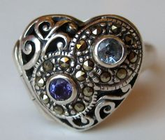 Vintage Ring Heart Shaped Jeweled Marcasite Sterling Silver Secret Compartment Ring size 9 1/2. $48.00, via Etsy.
