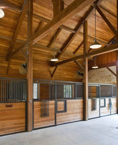 i like the overhead lighting horse barn lighting ideas | Found on texastimberframes.com