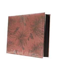 Photo albums don't have to be hidden away when they have covers that are this pretty! Add texture to your living room with this silk orchid photo album from Boots in this season's hottest colour! £15