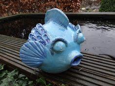 als een vis.....op het droge keramiek