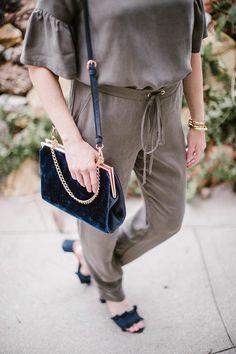 Paper Crown jumpsuit and LC Runway velvet handbag