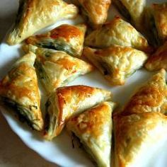These feta cheese and spinach triangles are a great starter and a great finger food for a party. Serve hot or cold.