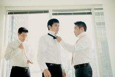 Groom in a black bow and the groomsmen in a soft pink tie
