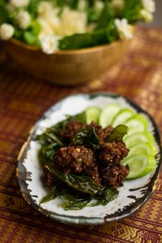 Laab Moo Tod is simply a fried version of the spicy Thai dish laab, and the addition of the crunchy exterior makes these great as an appetizer or party treat. | coolcathotfood.com