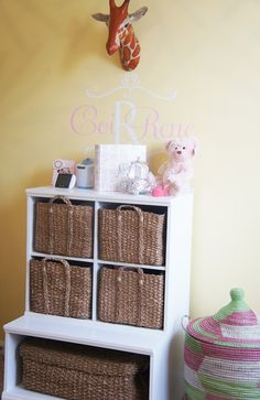 Yellow and pink modern nursery with a subtle safari theme. <3