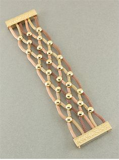 I think this could be adapted to kumihimo and instead of the gold beads use peyote bands. When I have time