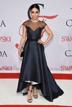Vanessa is rocking this elegant tea-length gown.