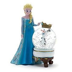 Disney Boule à neige Elsa et Olaf | Disney StoreBoule � neige Elsa et Olaf - On dirait bien qu'Olaf est devenu roi dans cette boule � neige La Reine des Neiges ! Il appara�t � l'int�rieur du d�me surmont� d'une couronne royale orn�e de strass, tandis qu'Elsa l'observe dans sa robe paillet�e.