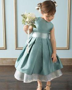 flower girl in blue / green shade dress