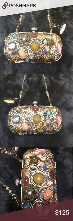 Mary Frances 12-479 Idol Clutch Mary Frances Idol Clutch (retired) AUTHENTIC needs a little work,some crystal strips are off refer to pic #5,not obvious but bring in to your best handbag restoration shop and it will be restored.  Comes with package of original beads & Mary frances logo charm. I price dropped this due to it needs some light repair done,nothing major. one inner hoop is sort of loose just needs to be tightened. -NO DUST BAG -NOT NEW-RETIRED! -NO CARD -NEEDS SOME LIGHT REPAIR…