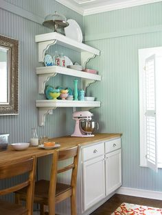 A Comfy Cottage Makeover with Vintage Style    Spot for Everything: Opposite the sink wall, a butcher-block countertop offers uninterrupted work space. When needed, the spot also works for casual dining. Shapely shelving keeps colorful dishes and serving pieces within easy reach. Bulky items stow easily in base cabinets.