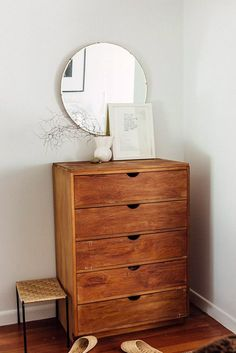 natural wood dresser with circular mirror. / sfgirlbybay