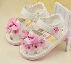 Girls sandals with flowers in colours pink, white, or red with pink flowers or multi coloured flowers. $6.50 from Aliexpress