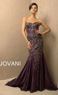 by Jovani. Strapless mermaid. Beaded from bodice to knee.  Dark amethyst w/silver tone beading