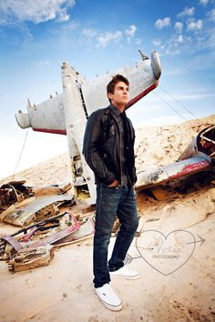 I like the idea of writing about a pilot. (Don't worry about that crashed plane in the background, he just needs a bit of practice.) ;) hehe!