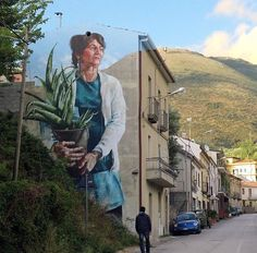 Street Art blending perfectly into the surrounding countryside by Fintan Magee. Sapri, Italy