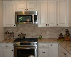 Travertine subway tile kitchen traditional with decorative drawer and cabinet handles tumbled travertine subway tile backspla french country kitchen fluer de lis canisters stainless steel appliances distressed cream cabinetry Traditional Kitchen Design, Rental Kitchen Makeover, Kitchen Renovation, Country Kitchen, New Kitchen Designs, French Country Kitchens, French Kitchen Design, Classic Kitchen Design, French Country Kitchen