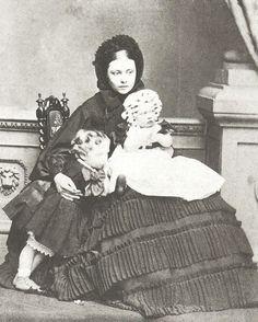 Queen Victoria's daughter Empress Victoria  with her oldest two children. Kaiser Wilhelm, Princess Charlotte