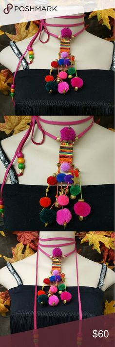 NEW ONE OF A KIND HAND MADE LEATHER WRAP CHOKER 💖HOST PICK💖 NEW ONE OF A KIND HAND MADE LEATHER WRAP CHOKER. Hot pink deerskin leather. Bohemian/Hmong style choker. Full of pom poms dangle beads and more. Absolutely a favorite of mine. Super fun and extra long for wrap styles. Bohemian Cowgirl Collection!! Creative Crystal Designs  Jewelry Necklaces
