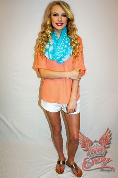 Just For Me Top in Peach - This classic short sleeve blouse is ideal for throwing on with almost any item in your closet. It's that comfy and trendy go-to top that completes virtually any look you are setting for. With a high-low hem and a relaxed fit, this top is perfection paired with shorts, pants, or skirts, plus it looks great layered under cardigans or vests. Not to mention it is lightweight and stylish. With front and back V-necks it is easy to accessorize with daint