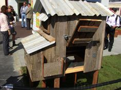 Great rustic chicken coop. Love the corrugated metal roof!