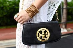 A sleek Tory Burch bag goes surprisingly well with a down-to-earth ensemble. Photos by Karla Garcia.
