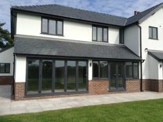 White render, red brick trim, grey windows and grey tile roof House Cladding, Exterior Cladding, Facade House, Exterior Windows, House With Grey Windows, House Windows, Brick Rendering, Brick Extension, Extension Plans