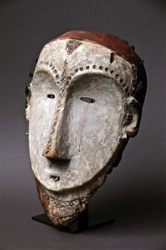 Africa | Mask from the Mitsogo people of Gabon |   Wood and pigment | Image ©Michel Renaudeau