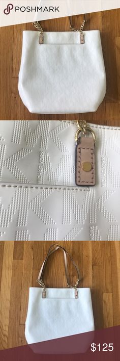 White Michael Kors Tote Purse Water resistant treated white outside with tan straps and gold chains. Lots of pockets and is in nearly perfect condition, some small marks here and there. MICHAEL Michael Kors Bags Shoulder Bags