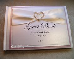 Luxury Personalised Wedding Guest Book. Fully decorated with layered pearlised card, quality satin ribbon, threaded with a beautiful