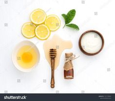 Top view of egg,yogurt,honey and lemon on white background in concept simple homemade hair mask.Natural hair care recipe with essential oils.Best natural hair care for long, strong and beautiful hair. Blonde Hair Care, Curly Hair Care, Natural Hair Care, Natural Hair Styles, Lemon Top, Honey Lemon, Hair Care Recipes, Homemade Hair, Top View