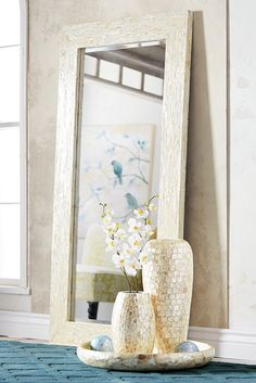 A small space is the perfect place to go big with elegance. Pier 1's exclusive Ivory Mother-of-Pearl Floor Mirror is crafted entirely by hand using a 90-day, multistep process and then lacquered to enhance the brilliant ivory sheen. This piece reflects why ancient seafaring cultures have always collected the shells for good luck. And lucky for you, it's sized to make any space feel roomier.