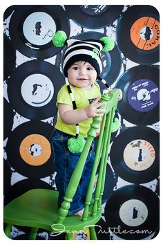baby photo session idea | green chair prop | record backdrop | pose ideas | music theme