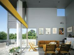 Modern open-plan living room with gray walls — Charles Gwathmey's Hamptons home built in 1965
