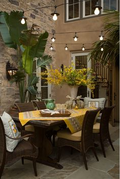 Bright color and European architectural detail combined with wicker and iron create and eclectic outdoor living space.