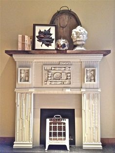 """scrap wood mantel  Faux mantel made with scraps of wood trims, thrift shop frames and broken spindles with chalkboard """"fire box.""""  #mantel #fauxmantel #scrapwood"""