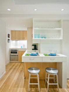 Um espaço bem leve.  http://www.decorfacil.com/55-cozinhas-em-l/