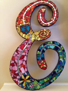 Letter mosaic by artist Emily Gunderson...would sooo attempt this with a J and a R in the future