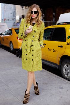 From fashgasmic.tumblr.com. The shape of the coat and the buttons make it classic. The bright color makes it modern. The pattern on the boots add a pop of interest.