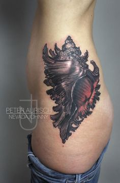 Peter Aurisch - Conch Shell tattoo  Great placement!