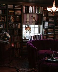 Yesterday we showed you an assortment of all-white interiors, and today we're headed in the opposite direction, towards all things dark and moody. If you love black walls and velvet and intricate textures and the perfect place to curl up with a book on a cold winter afternoon — have we got a treat for you.