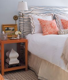 eclectic bedroom - blue zebra headboard by Travers; orange accent pillows are a Veneto print from Quadrille