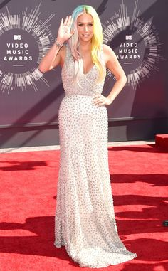 Kesha from 2014 MTV Video Music Awards Red Carpet Arrivals Kesha paired her candy-colored tresses with a glittering, floor-length gown.