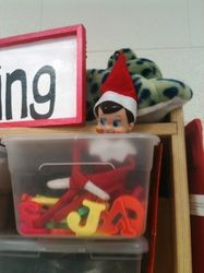 Classroom Elf on a Shelf.  Elf left message on the board with magnetic letters and then hid in the letter box!  Mrs. Witcher's Busy Bugs Website